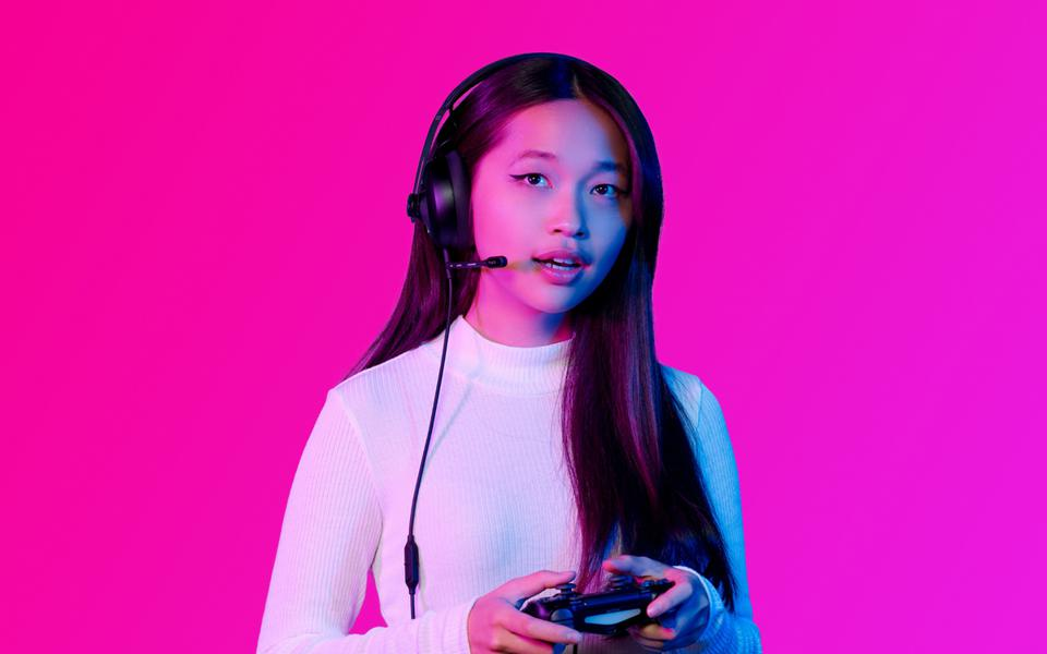 Woman wearing Nuraphone gaming headset
