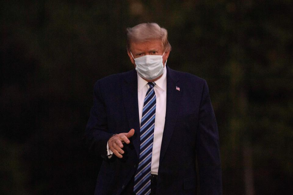 President Trump wears a mask after being told he's been infected with Covid-19.