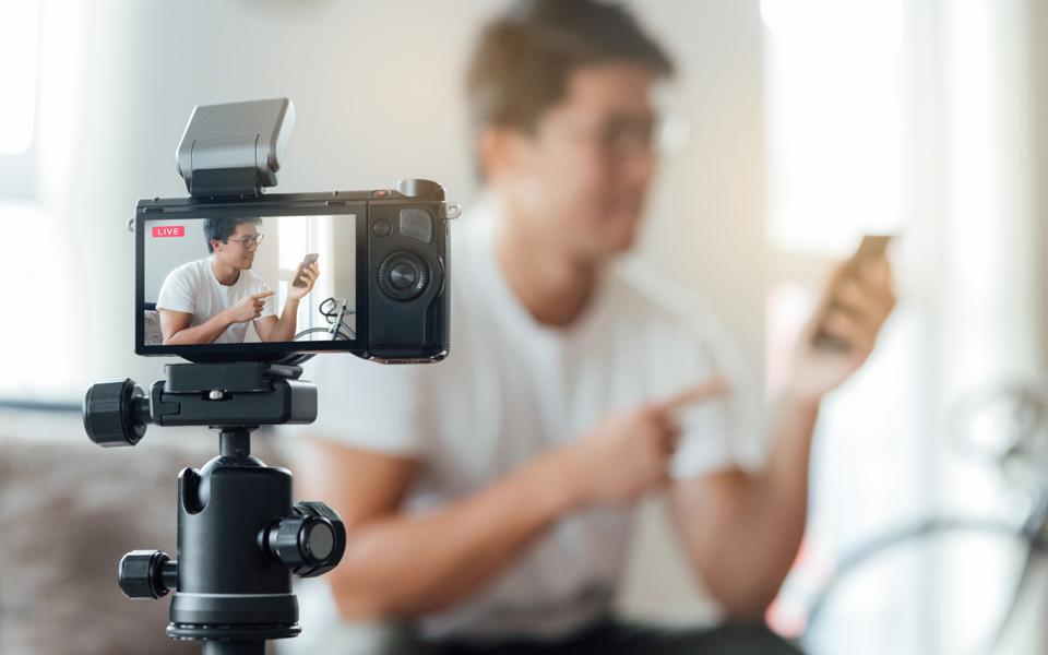 Young Man Vlogging Technology Product At Home