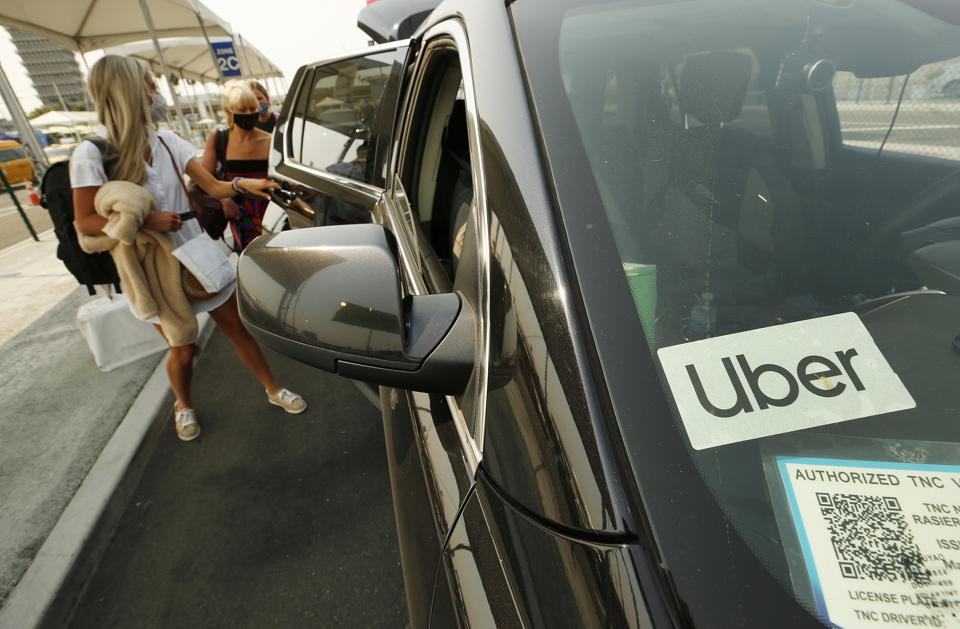 Uber and Lyft drivers with the Mobile Workers Alliance held a moving rally as part of a statewide day of action to demand that both ride-hailing companies follow California law and grant drivers basic employee rights and to denounce the corporations effort