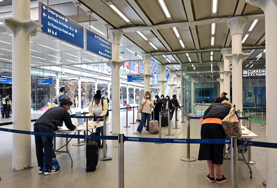 Passengers headed to France fill out forms at Eurostar terminal at St Pancras London UK