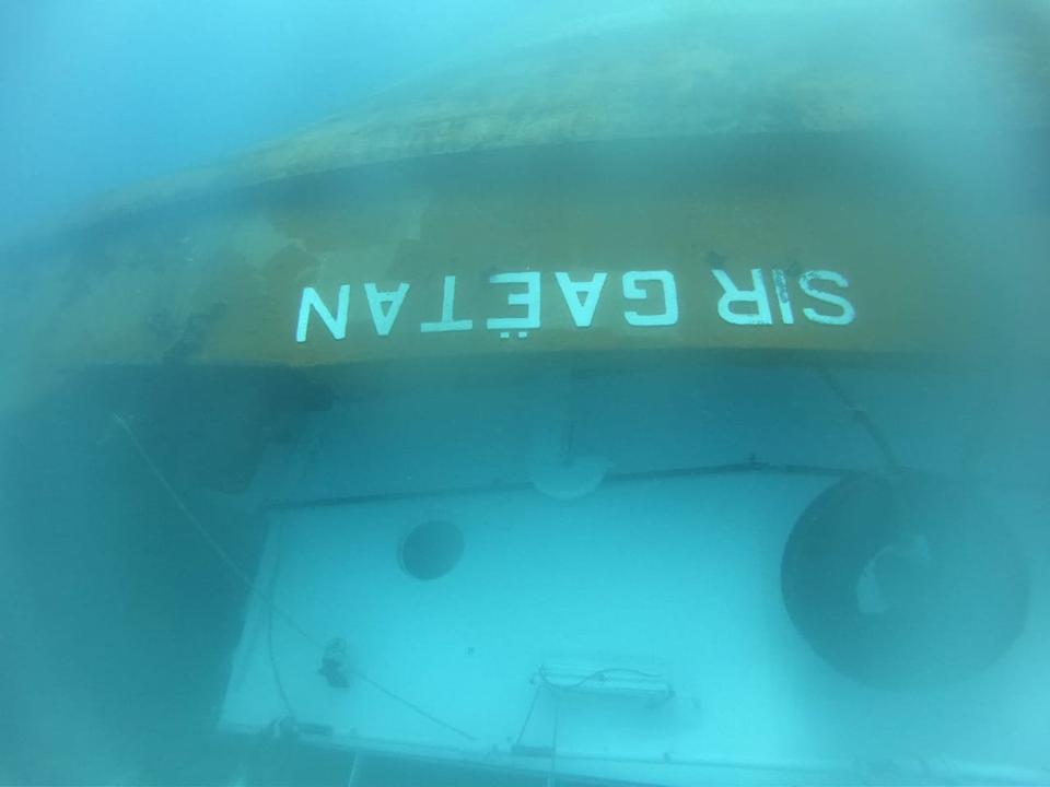 The upturned Mauritian Sir Gaetan tugboat, taken by Indian Navy divers three days after the sinking of the Wakashio salvage support vessel.
