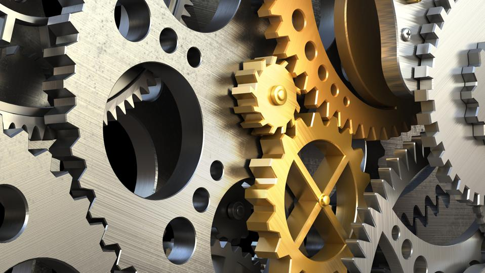 Mechanical automation achieved through the synchronized motion of interlocking gears.