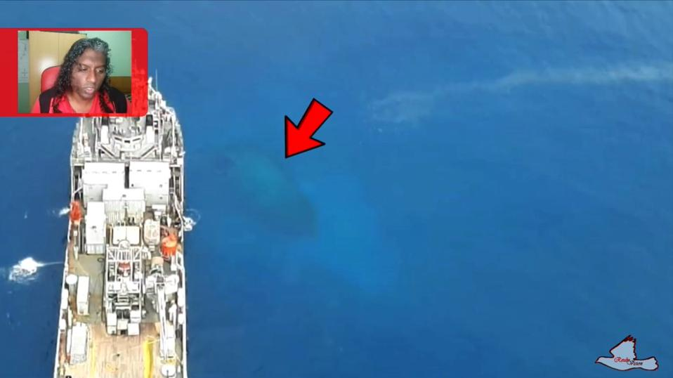 Hull of the sunken Sir Gaetan can be seen at 18 meter depth in the clear waters of Mauritius' coral lagoon.