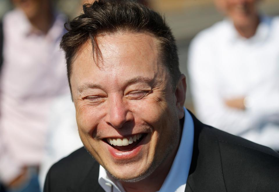 Tesla CEO laughs heartily as he jokes with the media at a visit to the construction site of a new European ″Gigafactory″ near Berlin last month.
