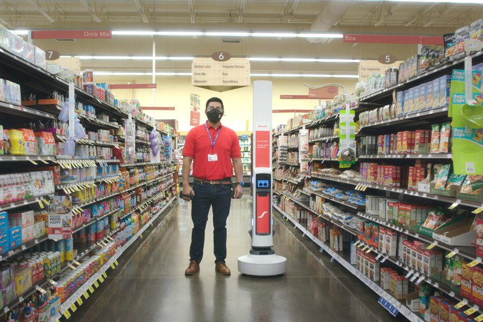 Tally robot next to a person.