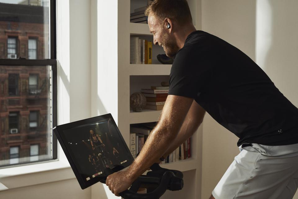 Man riding SoulCycle at-home bike in New York apartment