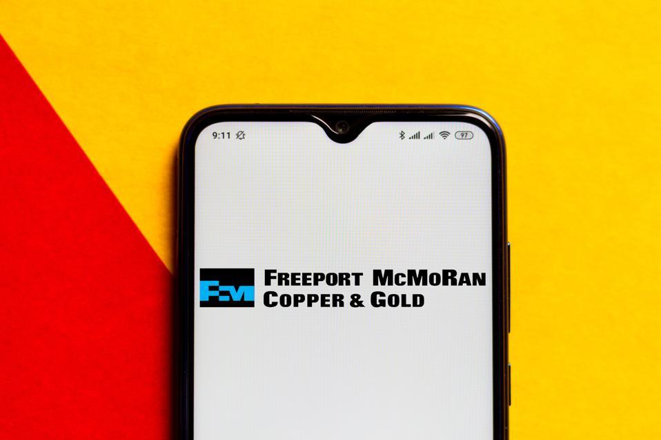 In this photo illustration the Freeport-McMoRan logo seen...