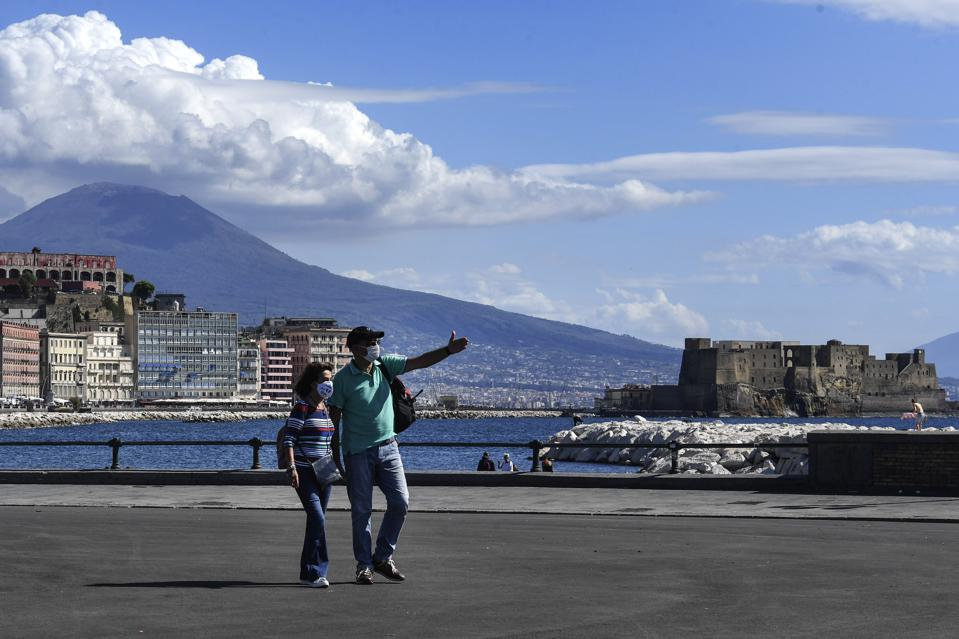 Tourists wearing protective masks on the seafront in Naples Italy