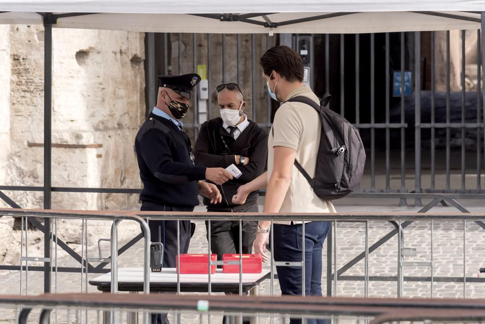 Man in mask at Colosseum as Face Masks Become Mandatory In Outdoor Areas Of Rome Italy