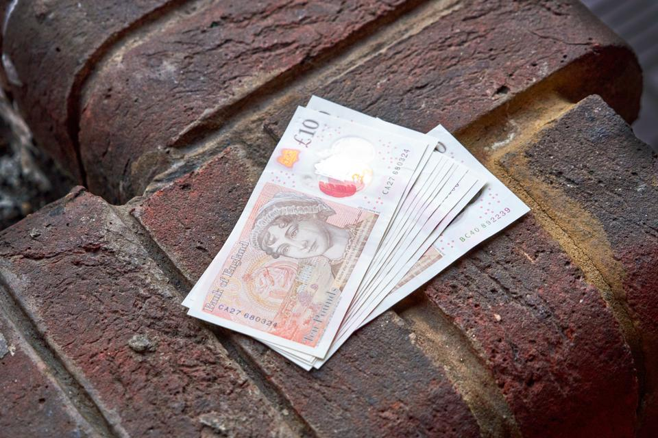 British pound banknotes, Concept quarantine and recession. Global economy hit by corona virus outbreak and pandemic