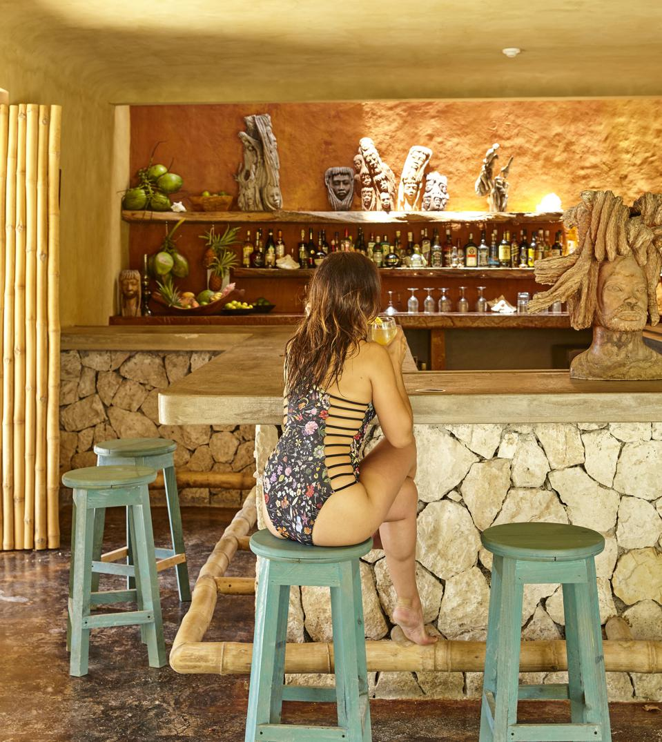 Woman at the bar at GoldenEye resort.