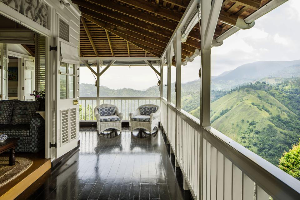 Veranda with mountain views at Strawberry Hill in Jamaica.