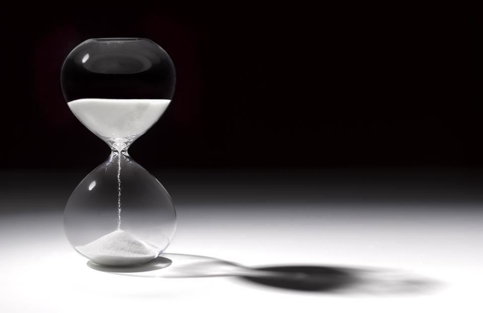 Hourglass time with sand running through