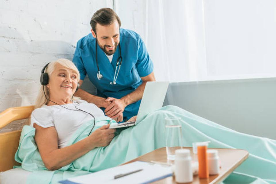 Doctor comforting patient with music.