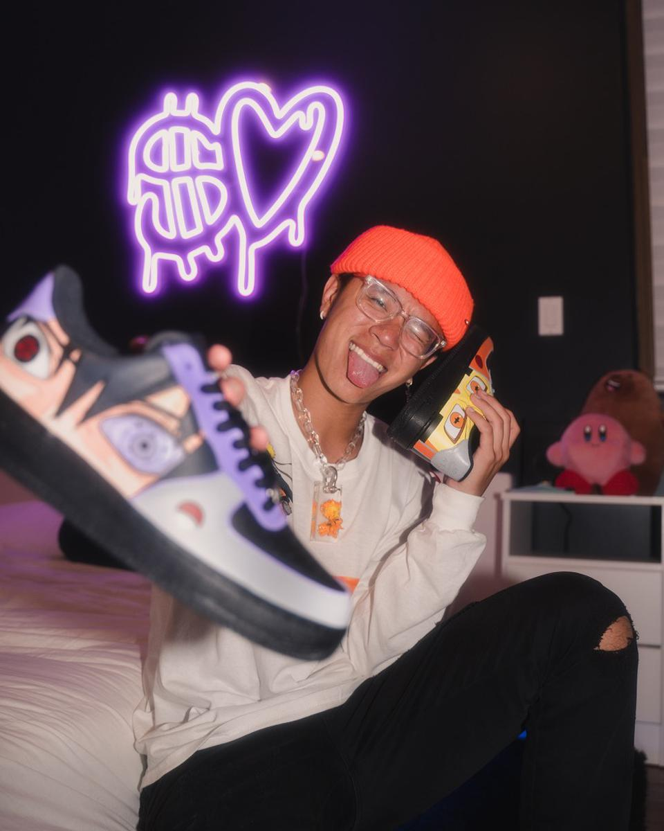 Michael Le is showing off a custom pair of sneakers
