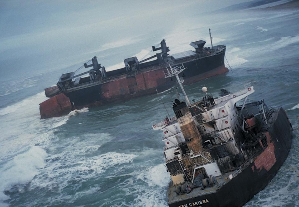 February 4, 1999: MV New Carissa, a 639-foot bulk freight ship of Panamanian registry, went hard aground in heavy seas about 150 yards off a stretch of remote, undeveloped sandy beach three miles north of Coos Bay, Oregon, USA. The ship was intentionally ignited to burn the fuel oil and later broke in two.
