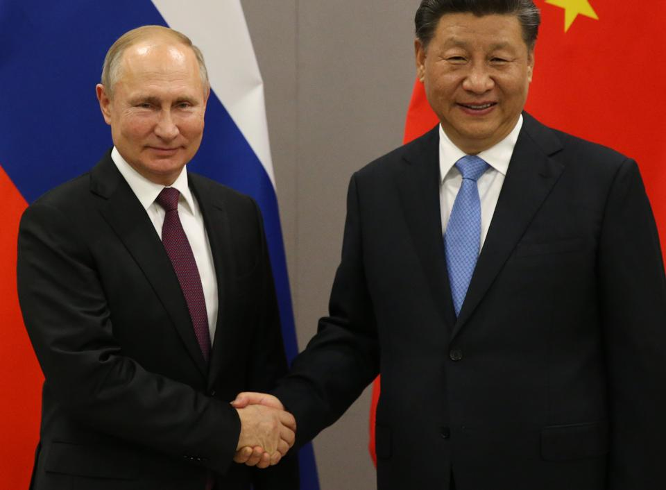 Russian President Vladimir Putin meets Chinese President Xi Jinping at BRICS Summit in Brasilia