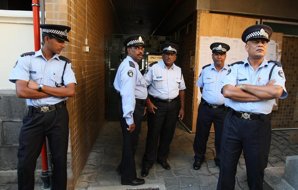 Police officers on duty outside the Supreme Court in Port Louis, Mauritius, on day ten of the trial of the murder of Irish citizen Michaela McAreavey in 2011.
