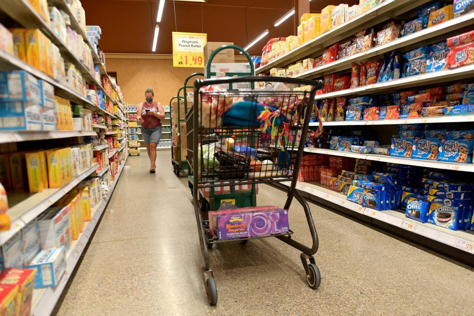 Instacart workers scramble to fill carts during pandemic stay-at-home orders.