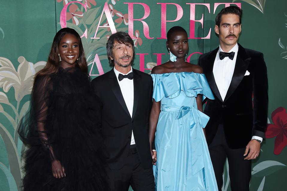 Pierpaolo Piccioli, Adut Akech, Jon Kortajarena and guest on the red carpet at the Green Carpet Fashion Awards