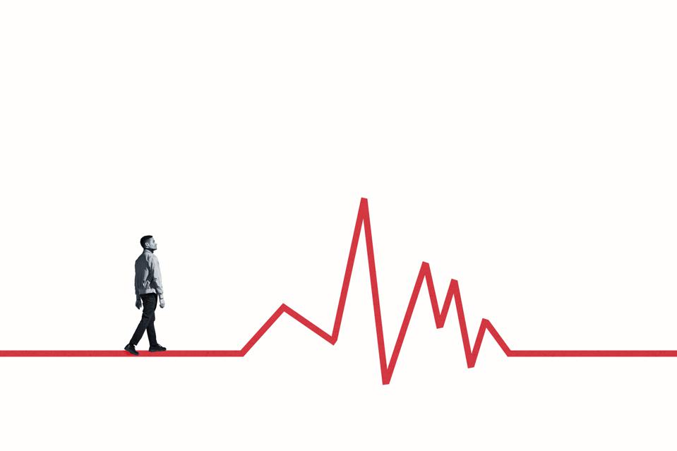 Side view of young man walking on red line graph