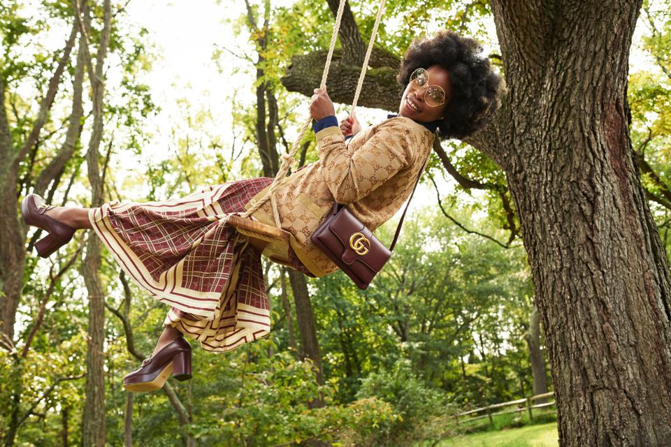 Head-to-toe Gucci models swing from tree swings in Gucci X commercials The RealReal.