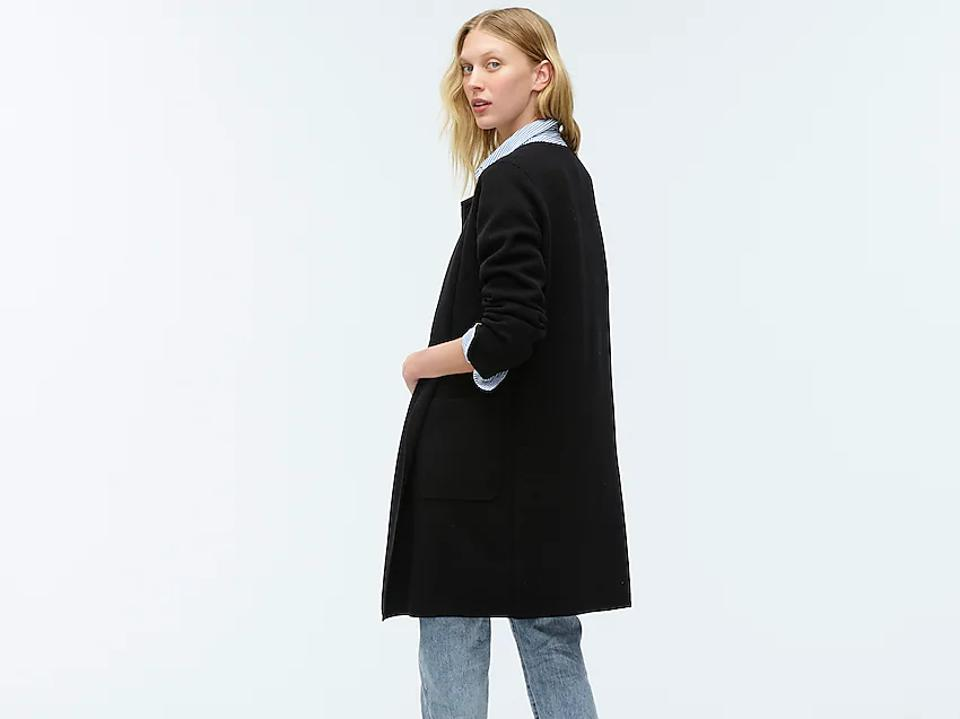 Woman in dark coat and jeans.