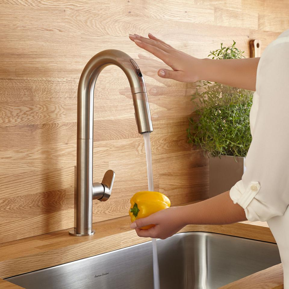 This sensor activated faucet is by American Standard.