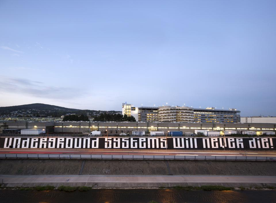 "L'Atlas inscribed the phrase ""Underground systems will never die!"" on a 170-meter-long wall for the Wiener Linien, Vienna's public transit network"