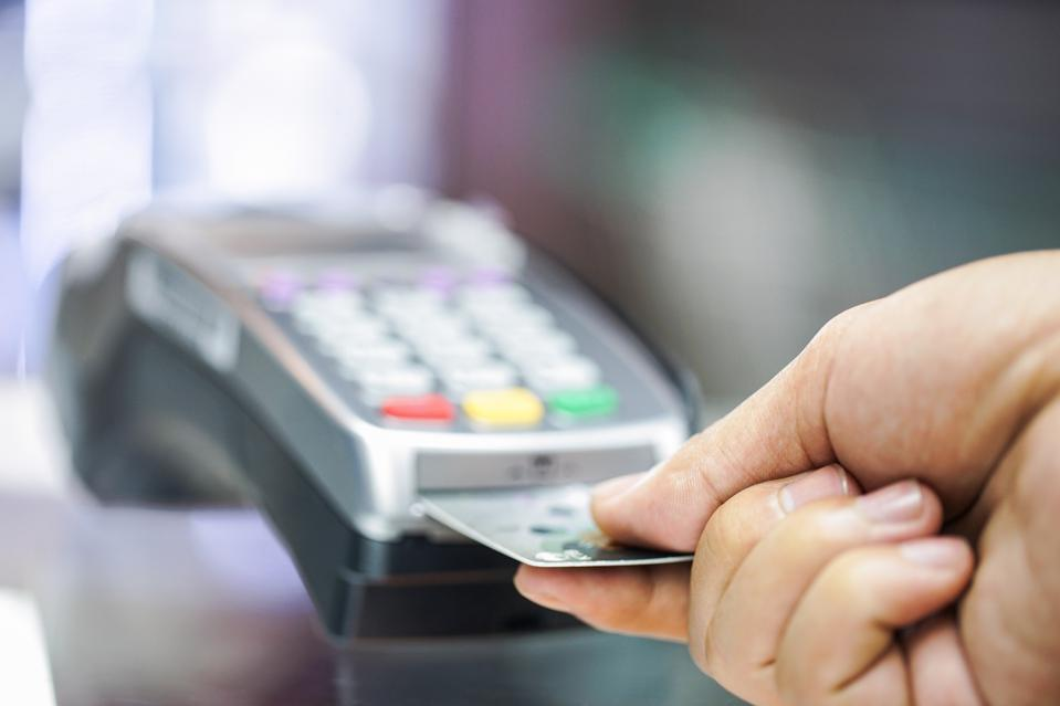 Credit card being inserted into payment device
