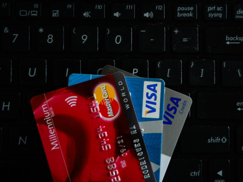 VISA and Mastercards credit cards are seen on  the top of a...