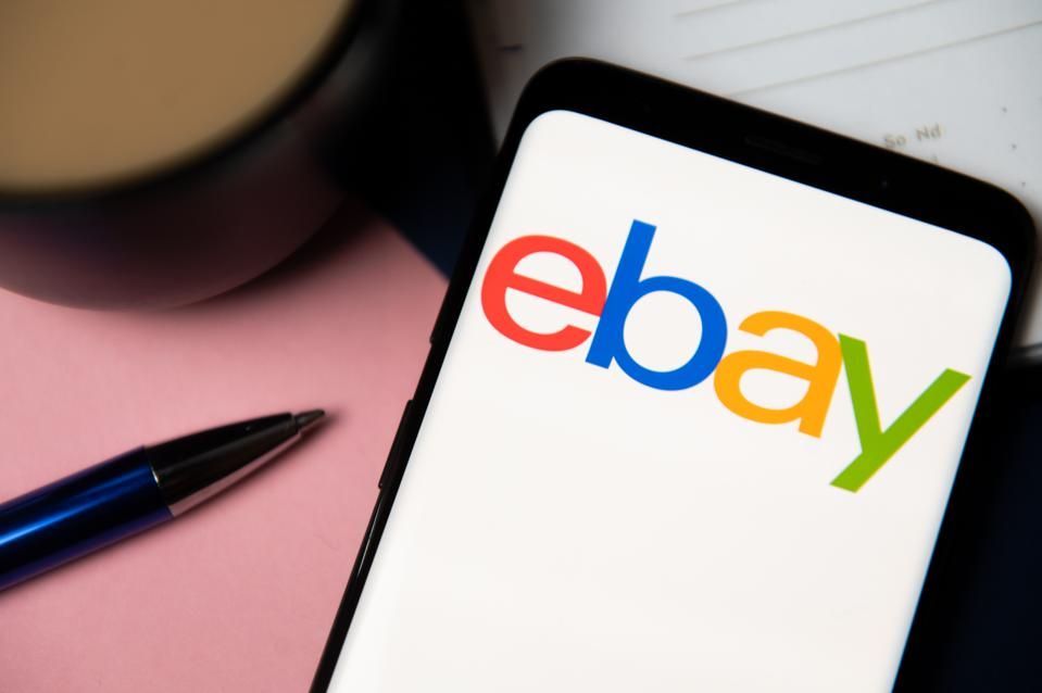 In this photo illustration a Ebay logo displayed on a...