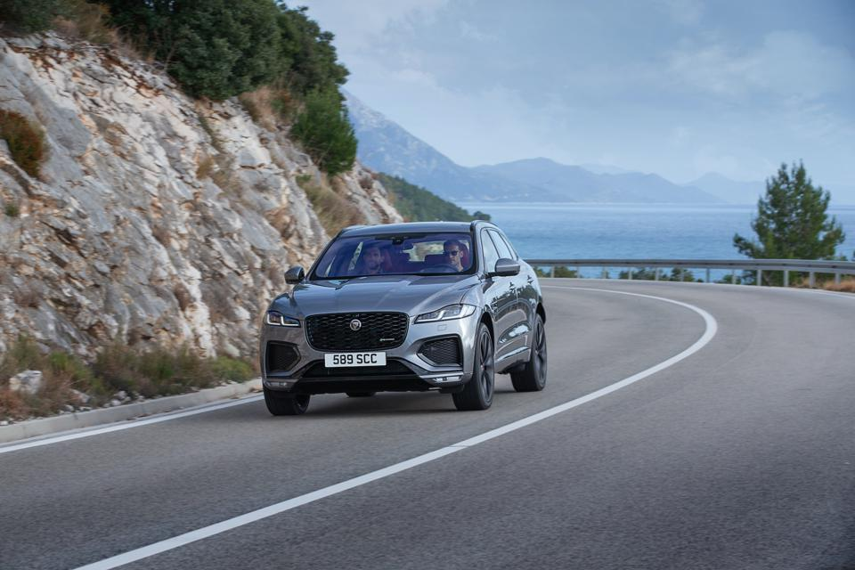 Front three-quarter view of a gray Jaguar F-Pace SUV