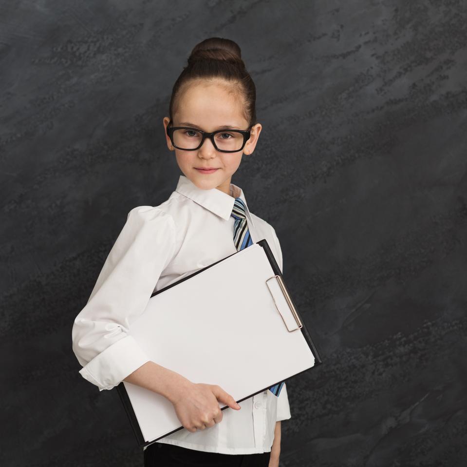 Child girl in formal wear, portrait of little businesswoman