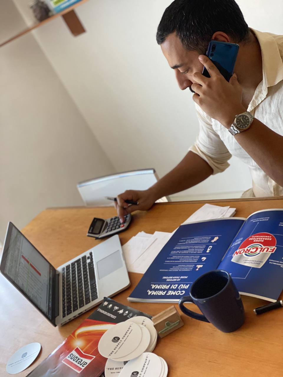 Salah el Busefi, founder of The Supply Company, at work at his desk.