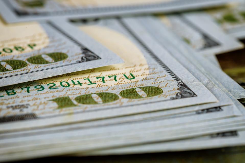 Hundred dollar bills pile