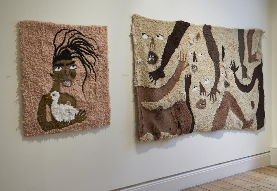 rugs on a wall