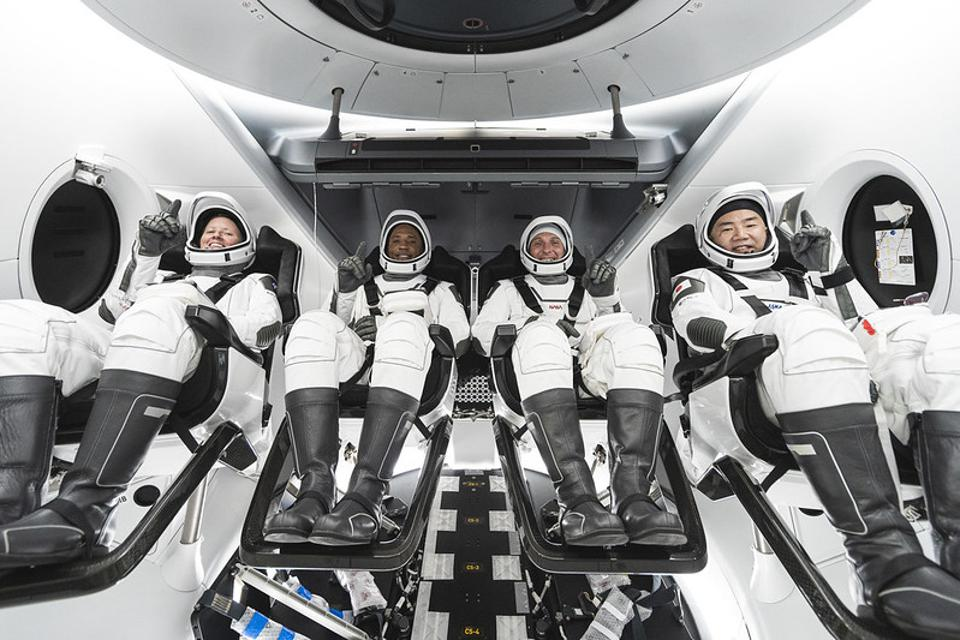 The SpaceX Crew-1 crew members (from left) NASA astronauts Shannon Walker, Victor Glover, Mike Hopkins, and JAXA (Japan Aerospace Exploration Agency) astronaut Soichi Noguchi.