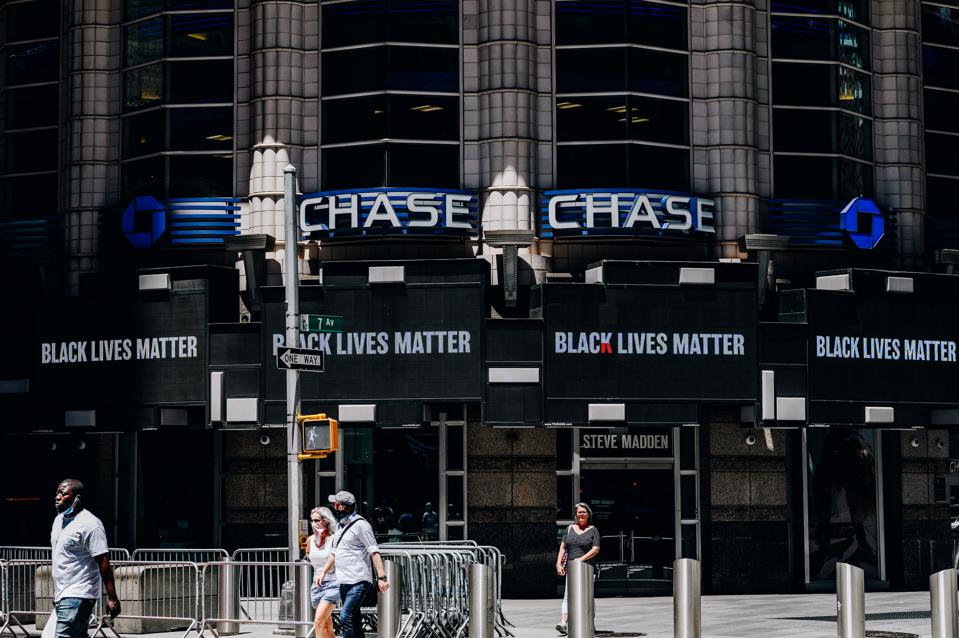 A 'Black Lives Matter' sign is displayed on Chase bank in Times Square in New York.
