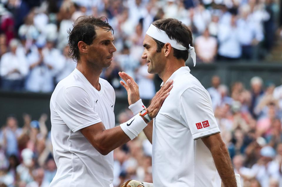 Roger Federer greets Rafael Nadal after their Men's Singles semi-final match during Day eleven of Wimbledon 2019.
