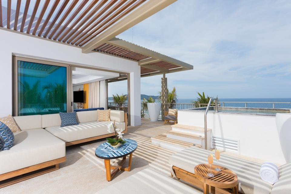 hotel balcony with private jacuzzi overlooking ocean