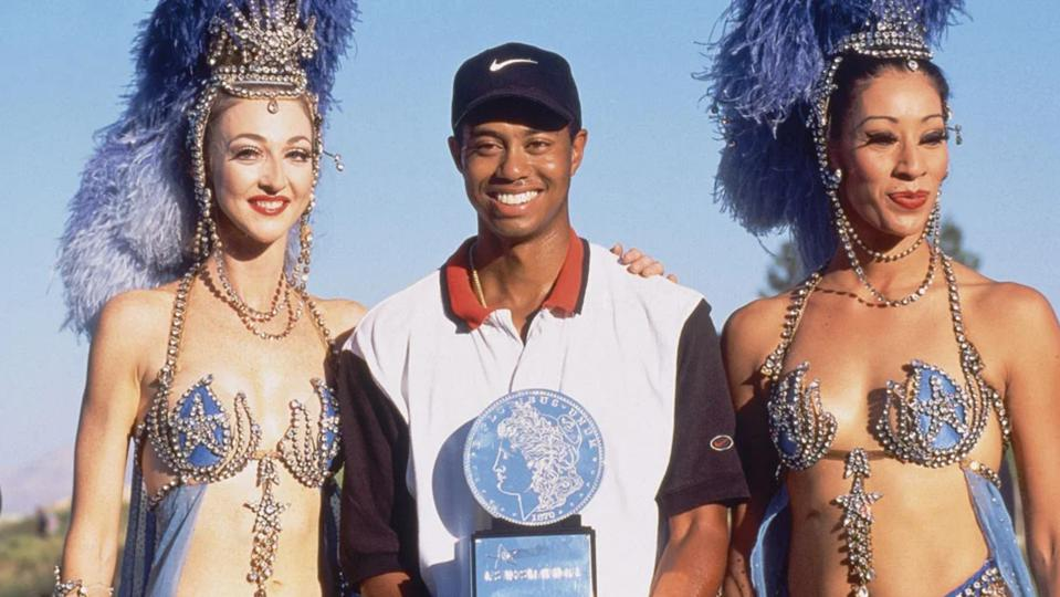 Tiger Woods with showgirls. He was won five Masters titles, 15 majors and 82 overall.