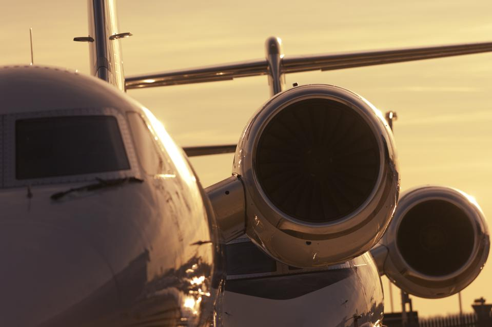 windshield and Honeywell 731 engines of a Gulfstream 5 with another parked behind