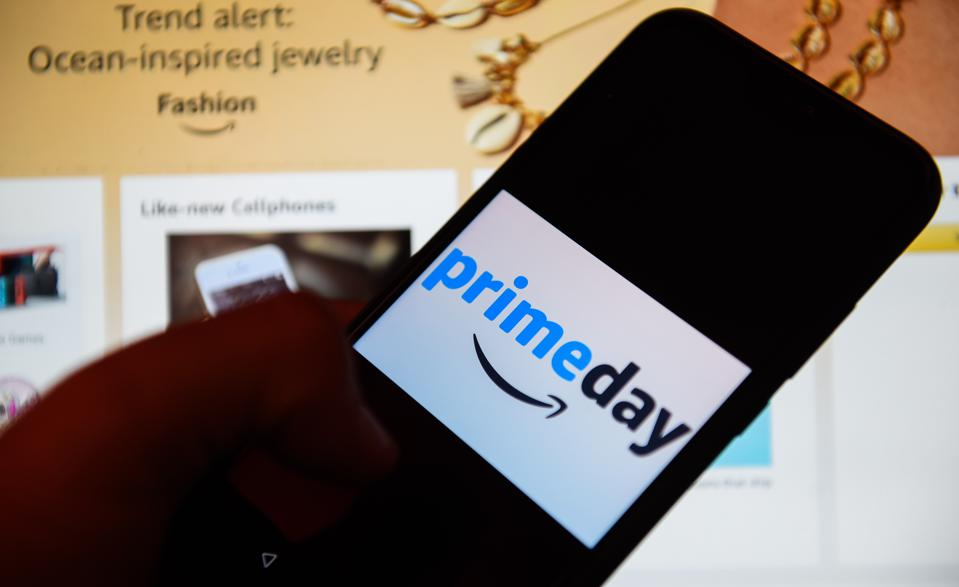 In this photo illustration an Amazon Prime day logo seen...