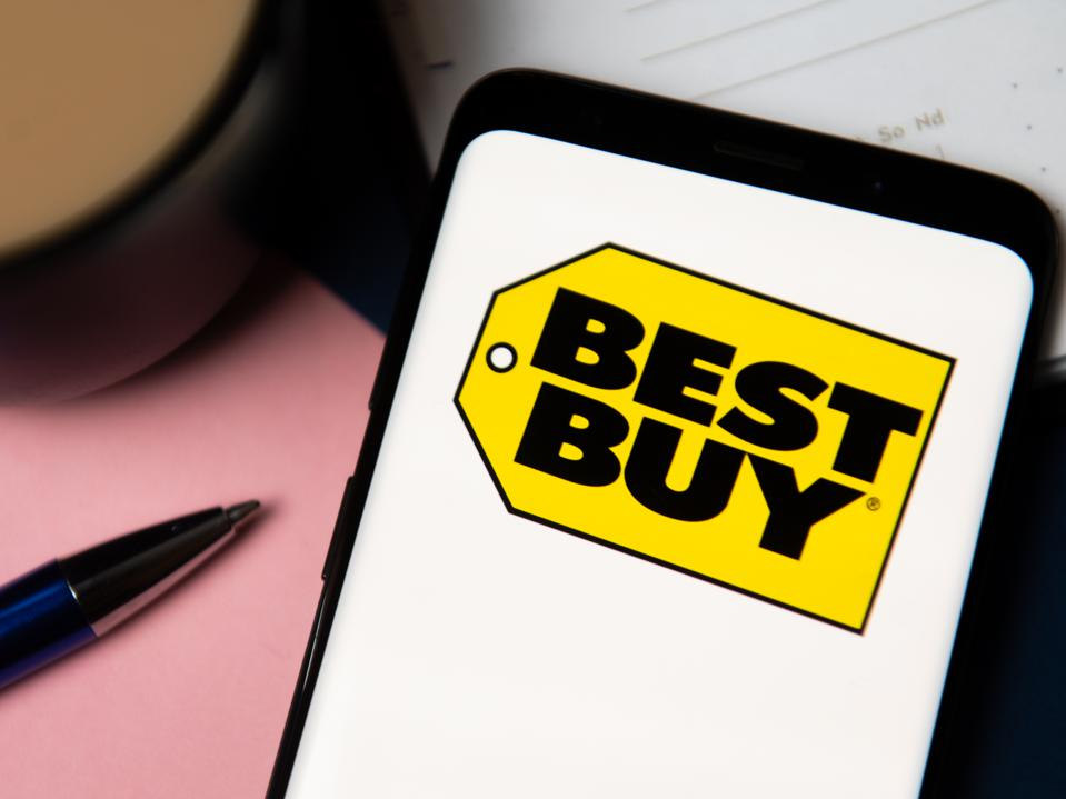 In this photo illustration a Best Buy logo displayed on a...