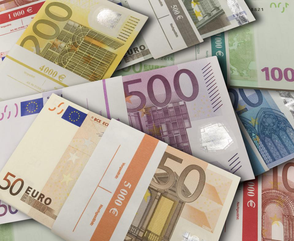 symbolic photo money, financial aid, taxes, currency, Euro banknotes with banderole