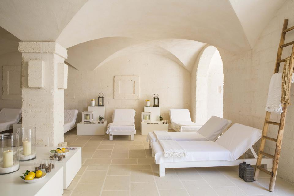 The spa at Borgo Egnazia in Puglia is a calming oasis with lounge beds draped in white.