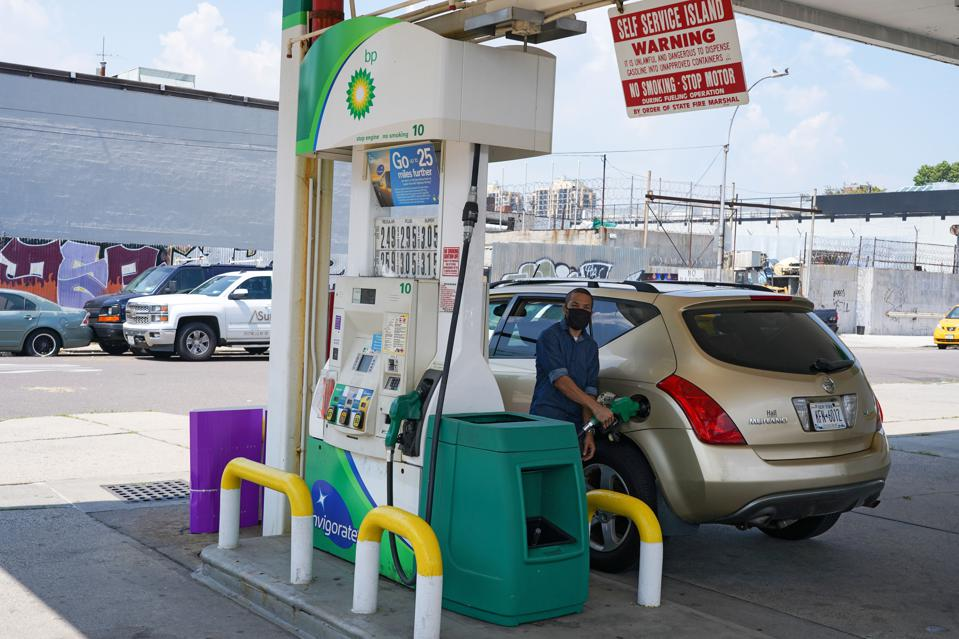 A motorist fills-up at a BP gas station in Queens Borough of...