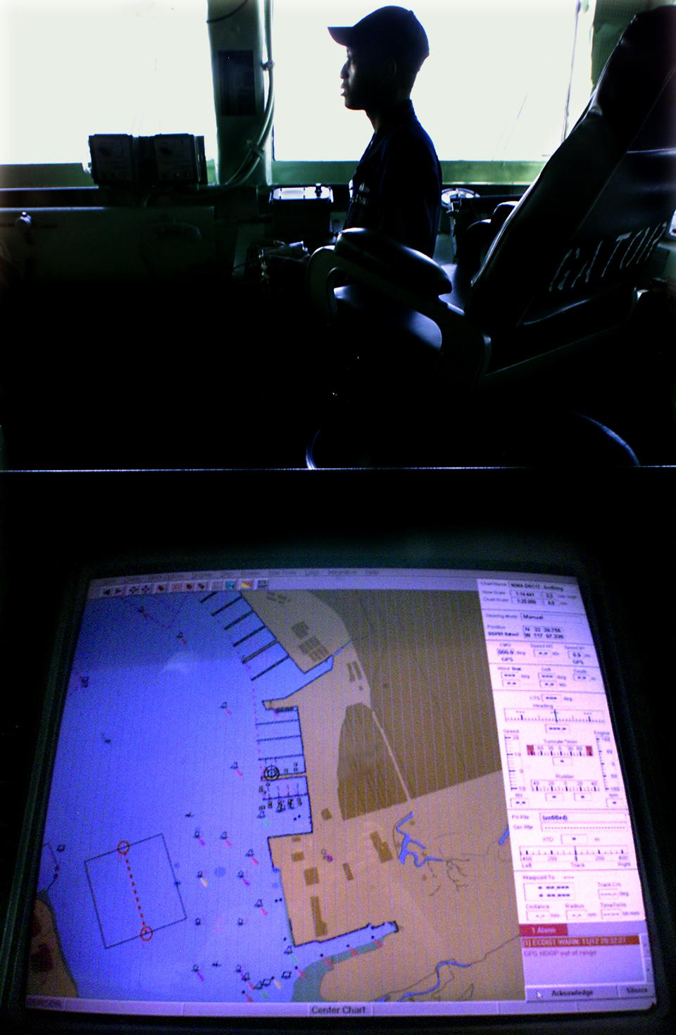 San Diego––A yound sailor looks out from the bridge as a ECDIS digital navigational charting system,